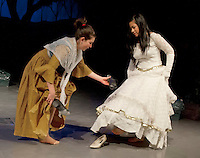 """The Baker's Wife (Alana Persson) attempts to trade shoes with Cinderella (Gabrielle Elumba) during """"Into The Woods"""" dress rehearsal Wednesday afternoon at Laconia Middle School.   (Karen Bobotas/for the Laconia Daily Sun)"""