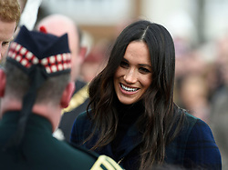 Meghan Markle meets Pony Major Mark Wilkinson during a walkabout on the esplanade at Edinburgh Castle, while on their visit to Scotland.