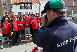 Embargoed to 0001 Monday August 28 Players from the Eccentric Flamingoes Cricket Club have their photo taken before their match against the Ship Inn Cricket Club on Sunday April 30th, 2017, in front of the pub in Elie, Fife, which is the only one in Britain to have a cricket team with a pitch on the beach. The Ship Inn Cricket Club season runs from May to September with dates of matches dependent on the tides. Any Batsman who hits a six which lands in the Ship Inn beer garden wins their height in beer and any spectator who catches a six in the beer garden also wins their height in beer.
