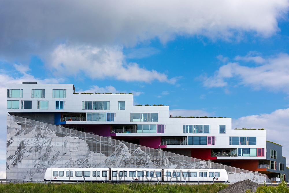 Ultra-modern new apartments with mountain range below and train on Orestads Boulevard, Copenhagen, Denmark