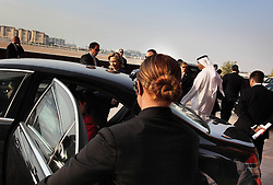 Brittany Cross opens a car door while working as part of Hillary Clinton's security detail in the United Arab Emirates, Jan. 10, 2011.