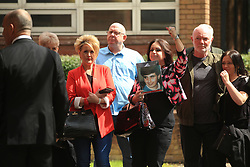 Donna Miller with a picture of her brother Paul Carlile, who died in the Hillsborough disaster, outside Warrington Magistrates' Court where five men are due to appear charged over the disaster and its aftermath.