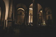 Merida, Mexico - November 27, 2014: Early in the evening, people worship and pray inside the Merida Cathedral in Mexico's Yucatan state.