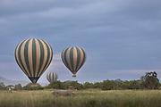 Three hot air balloons flying over the savannah in the Serengeti National Park, Tanzania