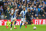 Brighton & Hove Albion defender Bernardo (30) and Manchester City midfielder Raheem Sterling (7) during the The FA Cup semi-final match between Manchester City and Brighton and Hove Albion at Wembley Stadium, London, England on 6 April 2019.