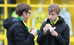 Norwich City fans enjoy a bite to eat prior to the match