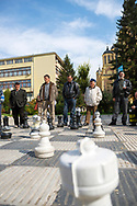 Men ponder the next move during an outdoor chess game in Sarajevo, Bosnia and Herzegovina