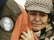 Elizabeth Esquivel holds onto her son Nicholas Garza as he speaks to the media outside Orange County Courthouse in Goshen about the Laura Garza case on Tuesday, Jan. 13, 2009. The family was in Goshen because Michael Mele was scheduled to appear in court, but he waived his appearance. Laura Garza was last seen with Mele in the Newburgh area.