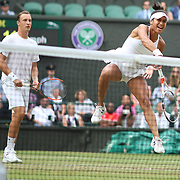 LONDON, ENGLAND - JULY 16: Heather Watson of Great Britain in action with Henri Kontinen of Finland in the Mixed Doubles Final on Center Court during the Wimbledon Lawn Tennis Championships at the All England Lawn Tennis and Croquet Club at Wimbledon on July 16, 2017 in London, England. (Photo by Tim Clayton/Corbis via Getty Images)