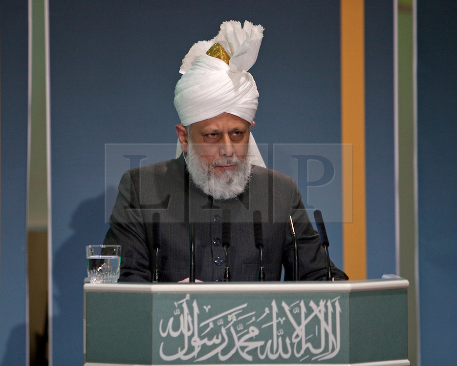 © Licensed to London News Pictures. 24/03/2012. Surrey, U.K..Hadhrat Mirza Masroor Ahmad speaks at Europe's largerst mosque, Baitul Futuh Mosque, in Morden, Surrey, which holds 10,000 worshipers. .Parliamentarians and religious, civic, charitable and community leaders meet here this evening 24/3/2012 for a National Peace Symposium on International Peace organised by the Ahmadiyya Muslim community to hear how Muslims are countering extremism..Photo credit : Rich Bowen/LNP