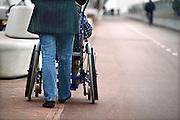 Nederland, Nijmegen, 26-11-2013 Eenvrouw duwt een rolstoel waar een oudere vrouw in zit. Ze wandelen over het fietspad.Foto: Flip Franssen/Hollandse Hoogte
