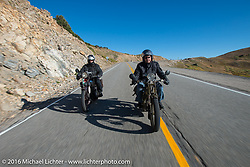 Ciro Nisi (R) of Italy riding his 1924 Moto Guzzi Sport along with fellow Italian Cannonballer Giuseppe Savoretti on his 1931 Moto Guzzi after crossing the Continental Divide at Loveland Pass during Stage 10 (278 miles) of the Motorcycle Cannonball Cross-Country Endurance Run, which on this day ran from Golden to Grand Junction, CO., USA. Monday, September 15, 2014.  Photography ©2014 Michael Lichter.