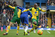 Youssuf Mulumbu of Norwich City (r) holds off Diego Costa of Chelsea. Barclays Premier league match, Chelsea v Norwich city at Stamford Bridge in London on Saturday 21st November 2015.<br /> pic by John Patrick Fletcher, Andrew Orchard sports photography.