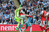 Claudio Bravo, the Manchester city goalkeeper saves from Laurent Koscielny of Arsenal (c).  The Emirates FA Cup semi-final match, Arsenal v Manchester city at Wembley Stadium in London on Sunday 23rd April 2017.<br /> pic by Andrew Orchard,  Andrew Orchard sports photography.