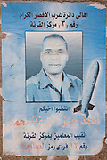 A local politician's regional elections poster in Arabic featuring a nuclear ballistic missile, seen on a lamp post in the modern city of Luxor, Nile Valley, Egypt.