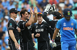 New Zealand's Colin de Grandhomme (second left) celebrates after taking the wicket of India's Virat Kohli (right) during the ICC Cricket World Cup Warm up match at The Oval, London.