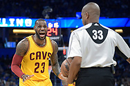 Cleveland Cavaliers forward LeBron James (23) argues a call with referee Sean Corbin (33) during the first half of an NBA basketball game against the Orlando Magic in Orlando, Fla., Saturday, March 11, 2017. (AP Photo/Phelan M. Ebenhack)