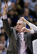 BYU head coach Dave Rose calls out a play during the second half of an NCAA college basketball game against Utah in Provo, Utah, Saturday, Feb. 12, 2011. BYU defeated Utah 72-59. (AP Photo/Colin E Braley)