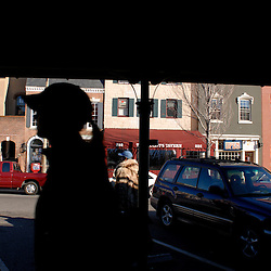 WASHINGTON, DC -  A girl in a baseball hat traverses one of the roofed stalls outside Eastern Market which looks over a bustling 7th St NE street of coffee shops, non-profits, taverns and restaurants...Photo by Susana Raab