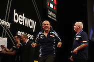 Phil 'The Power' Taylor celebrates a 180 score during his final match against Robert Thornton (right) in the Betway Premier League Darts at the Brighton Centre in Brighton, East Sussex. PRESS ASSOCIATION Photo. Picture date: Thursday 15th May, 2014. Photo credit should read: Chris Ison/PA Wire.