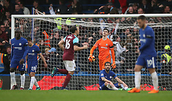 Chelsea goalkeeper Thibaut Courtois (third right) looks dejected during the Premier League match at Stamford Bridge, London.