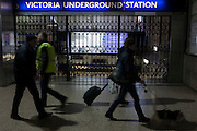Commuters walk past closed station gates at Victoria during the 24hr tube strike affecting Londoners and passengers throughout the capital, on 9th January 2017, at Victoria Station, London, England. The industrial action, coordinated by the Rail, Maritime and Transport (RMT) union and the Transport Salaried Staff's Association (TSSA), closed the vast majority of underground lines.