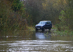 © Licensed to London News Pictures. 26/11/2012. Oxfordshire, UK A car left near the banks of the River Thames sits in floodwater. Flooding on the River Thames today 26th November 2012 in Oxfordshire. Photo credit : Stephen Simpson/LNP