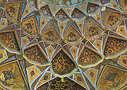 Stunning photographs reveal the beautiful ceilings in Iran's mosques, bazaars and public baths<br /> <br /> For the past few decades, restrictions on travel to Iran has meant the country has been largely shut off from the Western world, butas visa sanctions are lifted in the light of a landmark nuclear deal, the local tourism industry is hoping for a flurry of visitors.<br /> It's not hard to see why Iran is listed as one of the top travel destinations of 2016, with its rich culture and history.<br /> Among the standout aspects of the nation is its beautiful ancient architecture, with the cities and towns littered withornate and eye-catching mosques, public baths and markets.<br /> And unlike many other countries - the roof is not an afterthought, with many ceilings built as the centrepiece to the building, with many of the tile designs showcasing a display of intricate geometric patternsthatdate back several centuries.<br /> French photographerEric Lafforgue has travelled the country photographing the ceilings of indoor markets, mosques and bath houses.<br /> <br /> Photo shows: Ceiling With Its Intricate And Elaborate Patterns In Behesht Palace