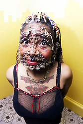Elaine Davidson, most pierced woman in the world, in these pictures taken in May, 2000.
