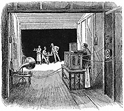 Edison's Kinetographic Theatre (c.1891). In this he combined the recording of sound and vision.  Engraving published London 1900.