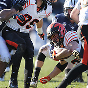 Running back Joe Rhattigan, Princeton, is tackled during the Yale Vs Princeton, Ivy League College Football match at Yale Bowl, New Haven, Connecticut, USA. 15th November 2014. Photo Tim Clayton
