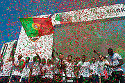 The portuguese team captain Cristiano Ronaldo and other portuguese football players speaking to the crowd of portuguese supporters at Alameda Dom Afonso Henriques, in Lisbon. Portugal's national squad won the Euro Cup the day before, beating in the final France, the organizing country of the European Football Championship, in a match that ended 1-0 after extra-time.