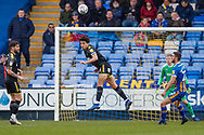 Wimbledon defender Will Nightingale (5) clears the ball with his head during the EFL Sky Bet League 1 match between Shrewsbury Town and AFC Wimbledon at Greenhous Meadow, Shrewsbury, England on 2 March 2019.