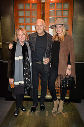 Left to right, MARTINE MONTGOMERY, DAVID MONTGOMERY and their daughter MARISSA MONTGOMERY at a private view of Made in Britain featuring contents from The Ivy sold to benefit Child Bereavement UK held at Sotheby's, 34-35 New Bond Street, London on 23rd March 2015.