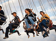 A couple enjoys the swing ride at the South Carolina Coastal Fair in Charleston, SC.
