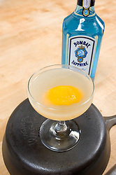 Bombay Sapphire Savoy by James Moreland,set upon an iron skillet ion a wooden cutting board n a beautiful open New York kitchen.