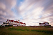 Clouds move over the popular Spring House Inn during a dusky afternoon in Block Island.