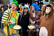 Compare and competitors at the Great Spitalfields Pancake Race on Shrove Tuesday, pancake day, at the Old Truman Brewery, London, UK. This is a fun quirky annual event where competitors come as teams of four people dressed up in costume of some kind. Organised by Alternative Arts raising money for charity.