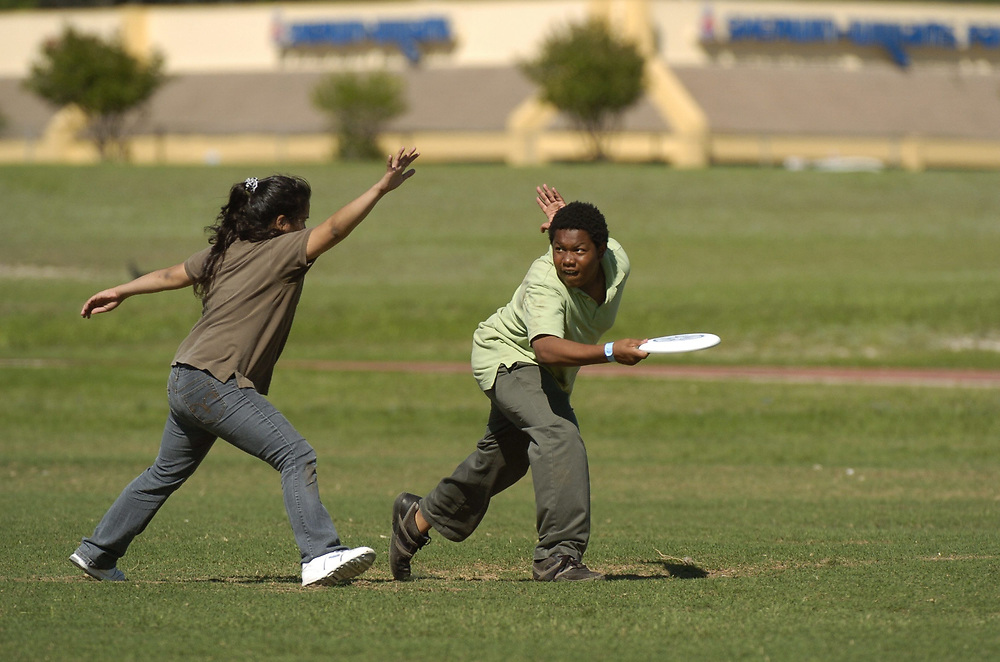 """Austin, TX April 25, 2007: Junior high students play """"Ultimate Frisbee"""" after school, a non-contact game that's a combination of flag football, soccer and frisbee.    ©Bob Daemmrich /"""