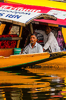 Man smoking a hookah pipe on board a shikara (boat) on Dal Lake in Srinagar, Kashmir, Jammu and Kashmir State, India.