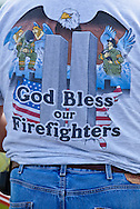 Man wearing a T-shirt tribute to the twin towers and firefighters at  the Flight 93 National Memorial site where the flight crashed in Shanksville Pennsylvania on 9/11 2001. The temporary site will close on Sept. 9th at 4 P.M. and on Sept. 10 the official memorial will open in time for the 10th anniversary of 9/11