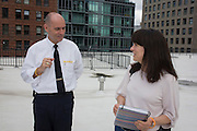 Writer Polly Morland and Investigative Engineering Services, Assistant Commissioner Tim Lynch, researching the chapter entitled 'The Skyline' for her book 'Risk Wise: Nine Everyday Adventures' by Polly Morland (Allianz, The School of Life, Profile Books, 2014), on the roof of the federal NYC Department of Buildings on Broadway.