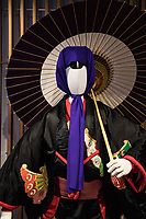 Kabuki Costume - Kabuki is a traditional Japanese form of theater developed during the Edo Period.  Kabuki is rich in showmanship and involves elaborately designed costumes, outlandish wigs, extraordinary makeup and exaggerated actions performed by the actors. Highly stylized movements convey meaning to the audience; this is especially important since an old-fashioned form of Japanese is typically used, which is difficult for speakers of modern Japanese to fully understand.  Plots are based on historical events, moral conflicts, love stories, tales of tragedy of conspiracy, and other well-known stories.  Dynamic stage sets: revolving platforms and trapdoors allow for the quick changing of a scene or the appearance or disappearance of actors.  Another specialty of the kabuki stage is a footbridge that leads through the audience, allowing for a dramatic entrance or exit. Ambiance is aided with live music performed using traditional instruments. These elements combine to produce a stunning performance.  Kabuki is recognized as one of Japan's three major classical theaters along with noh and bunraku, and has been named as a UNESCO Intangible Cultural Heritage.