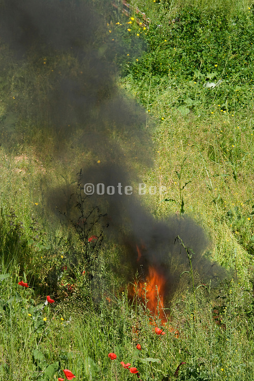 burning a tar kind of material which cases the black smoke