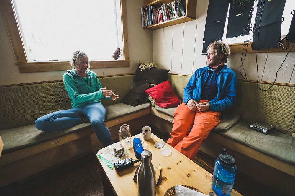 Casey Howard and Travis Green review their ski day at the Meadow Hut, Esplanade Range, BC.