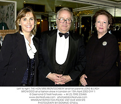 Left to right, THE HON.MRS MONTGOMERY and her parents LORD & LADY BIRDWOOD at a fashion show in London on 15th April 2002.OYY 1