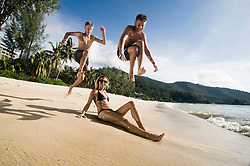 mother with two teenage sons at beach, Penang, Malaysia