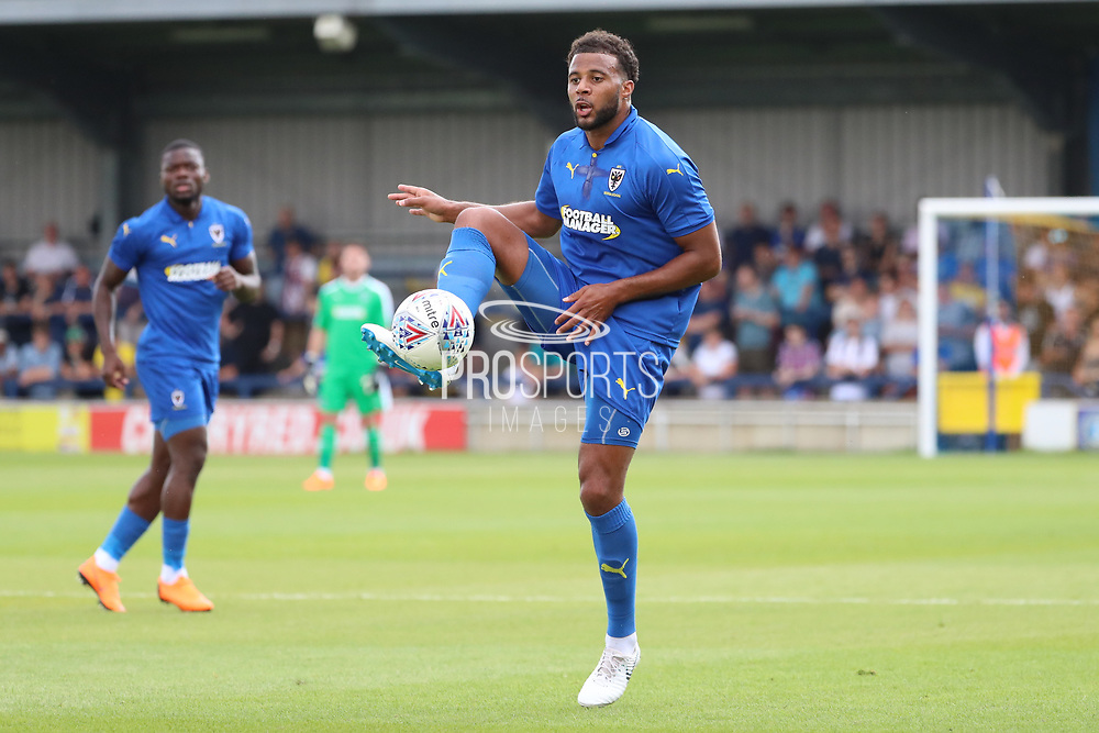 AFC Wimbledon midfielder Tom Soares (19) controlling the ball during the Pre-Season Friendly match between AFC Wimbledon and Queens Park Rangers at the Cherry Red Records Stadium, Kingston, England on 14 July 2018. Picture by Matthew Redman.