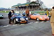 John Coundley (32) brown Jaguar E-type car and Bill de Selincourt (33), Jaguar Lister 'Knobbly' car, Sports car racing Goodwood, March 1961 on the start start line