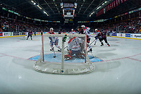 KELOWNA, BC - SEPTEMBER 21:  Dillon Hamaliuk #22 of the Kelowna Rockets stands in front of the net for a shot on Campbell Arnold #1 of the Spokane Chiefs during third period against the Kelowna Rockets  at Prospera Place on September 21, 2019 in Kelowna, Canada. (Photo by Marissa Baecker/Shoot the Breeze)